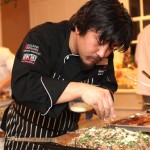 """Chef Edward Lee applied a final touch to his dish """"vension risotto""""."""
