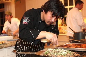 "Chef Edward Lee applied a final touch to his dish ""vension risotto""."